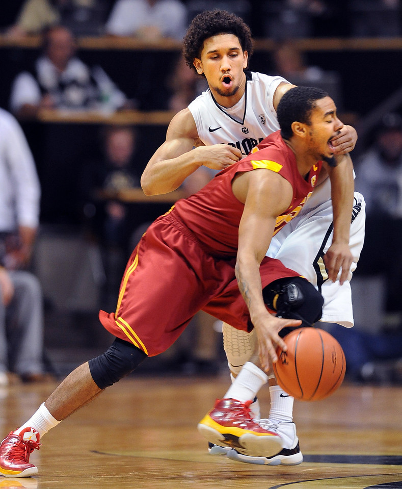 Jio Fontan of Southern California tries to get past Askia Booker of Colorado during the first half of the January 10, 2013 game in Boulder.<br /> Cliff Grassmick / January 10, 2013