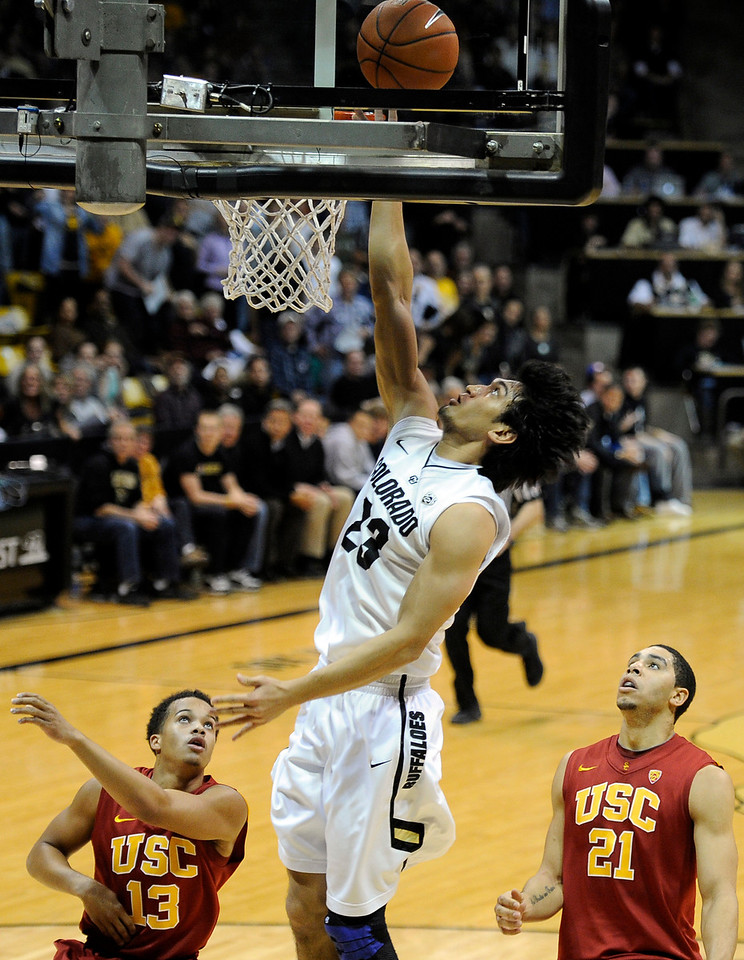"University of Colorado's Sabatino Chen goes for a layup over Chass Bryan, No. 13, and Aaron Fuller, No. 21, during a game against the University of Southern California on Thursday, Jan. 10, at the Coors Event Center on the CU campus in Boulder. For more photos of the game go to  <a href=""http://www.dailycamera.com"">http://www.dailycamera.com</a><br /> Jeremy Papasso/ Camera"