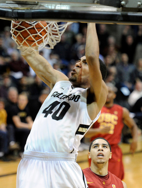 "University of Colorado's Josh Scott dunks the ball after a fast break during a game against the University of Southern California on Thursday, Jan. 10, at the Coors Event Center on the CU campus in Boulder. For more photos of the game go to  <a href=""http://www.dailycamera.com"">http://www.dailycamera.com</a><br /> Jeremy Papasso/ Camera"