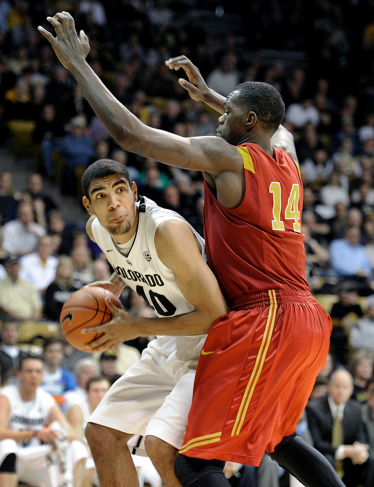 "University of Colorado's Josh Scott drives past DeWayne Dedmon during a game against the University of Southern California on Thursday, Jan. 10, at the Coors Event Center on the CU campus in Boulder. For more photos of the game go to  <a href=""http://www.dailycamera.com"">http://www.dailycamera.com</a><br /> Jeremy Papasso/ Camera"