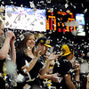 "CU fans celebrate the first basket of the game for CU.<br /> For more photos of the game, go to  <a href=""http://www.dailycamera.com"">http://www.dailycamera.com</a>.<br /> December 31, 2011 / Cliff Grassmick"