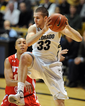 """Austin Dufault of Colorado gets to a rebound in front of Dijon Farr of Utah during the second half of the December 31, 2001 game in Boulder.<br /> For more photos of the game, go to  <a href=""""http://www.dailycamera.com"""">http://www.dailycamera.com</a>.<br /> December 31, 2011 / Cliff Grassmick"""