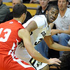 "Jeremy Adams of CU looks to pass against Kyle Perkins of Utah<br /> during the second half of the December 31, 2001 game in Boulder.<br /> For more photos of the game, go to  <a href=""http://www.dailycamera.com"">http://www.dailycamera.com</a>.<br /> December 31, 2011 / Cliff Grassmick"