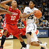 "Spencer Dinwiddie of Colorado, drives on Dijon Farr of Utah <br /> during the first half of the December 31, 2001 game in Boulder.<br /> For more photos of the game, go to  <a href=""http://www.dailycamera.com"">http://www.dailycamera.com</a>.<br /> December 31, 2011 / Cliff Grassmick"