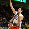 "Shane Harris-Tunks of CU drives into Kareem Storey of Utah<br /> during the first half of the December 31, 2001 game in Boulder.<br /> For more photos of the game, go to  <a href=""http://www.dailycamera.com"">http://www.dailycamera.com</a>.<br /> December 31, 2011 / Cliff Grassmick"