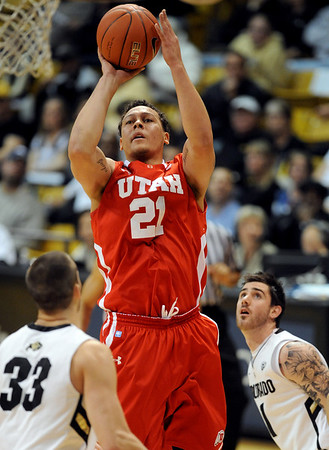 "Javon Dawson of Utah shoots over Austin Dufault (33) of Colorado <br /> during the first half of the December 31, 2001 game in Boulder.<br /> For more photos of the game, go to  <a href=""http://www.dailycamera.com"">http://www.dailycamera.com</a>.<br /> December 31, 2011 / Cliff Grassmick"