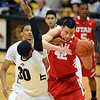 "Jason Washburn (42) of Utah, tries to drive through Carlon Brown of Colorado during the first half of the December 31, 2001 game in Boulder.<br /> For more photos of the game, go to  <a href=""http://www.dailycamera.com"">http://www.dailycamera.com</a>.<br /> December 31, 2011 / Cliff Grassmick"