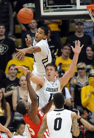 """Andre Roberson, top, of Colorado blocks the shot of Josh Watkins of Utah, with Shane Harris-Tunks of CU also defending <br /> during the second half of the December 31, 2001 game in Boulder.<br /> For more photos of the game, go to  <a href=""""http://www.dailycamera.com"""">http://www.dailycamera.com</a>.<br /> December 31, 2011 / Cliff Grassmick"""