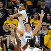 "Andre Roberson, top, of Colorado blocks the shot of Josh Watkins of Utah, with Shane Harris-Tunks of CU also defending <br /> during the second half of the December 31, 2001 game in Boulder.<br /> For more photos of the game, go to  <a href=""http://www.dailycamera.com"">http://www.dailycamera.com</a>.<br /> December 31, 2011 / Cliff Grassmick"