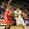 "Askia Book of Colorado, drives on Kareem Storey of Utah<br /> during the first half of the December 31, 2001 game in Boulder.<br /> For more photos of the game, go to  <a href=""http://www.dailycamera.com"">http://www.dailycamera.com</a>.<br /> December 31, 2011 / Cliff Grassmick"