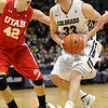 "Austin Dufault of Colorado drives on Jason Washburn of Utah<br /> during the first half of the December 31, 2001 game in Boulder.<br /> For more photos of the game, go to  <a href=""http://www.dailycamera.com"">http://www.dailycamera.com</a>.<br /> December 31, 2011 / Cliff Grassmick"