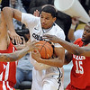 "Andre Roberson, center, of Colorado, battles with Cedric Martin, left, and Josh Wadkins, both of Utah during the first half of the December 31, 2001 game in Boulder.<br /> For more photos of the game, go to  <a href=""http://www.dailycamera.com"">http://www.dailycamera.com</a>.<br /> December 31, 2011 / Cliff Grassmick"