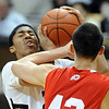 "Spencer Dinwiddie of CU tries to score on  Jason Washburn of Utah<br /> during the second half of the December 31, 2001 game in Boulder.<br /> For more photos of the game, go to  <a href=""http://www.dailycamera.com"">http://www.dailycamera.com</a>.<br /> December 31, 2011 / Cliff Grassmick"