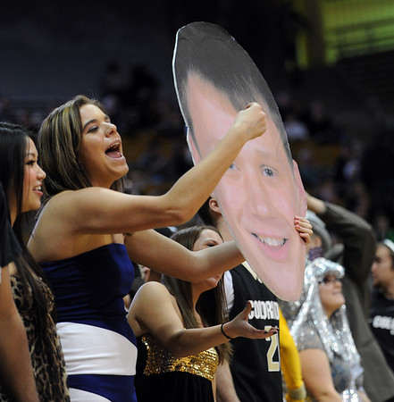 "This CU fan shows her top choice of players, Ben Mills,<br /> during the first half of the December 31, 2001 game in Boulder.<br /> For more photos of the game, go to  <a href=""http://www.dailycamera.com"">http://www.dailycamera.com</a>.<br /> December 31, 2011 / Cliff Grassmick"