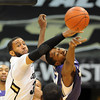 """Carlon Brown , left, of Colorado, and Terrence Ross of Washington, fight for a rebound during the first half of the January 5, 2012 game in Boulder.<br /> For more photos of the game, go to  <a href=""""http://www.dailycamera.com"""">http://www.dailycamera.com</a>.<br /> January 5, 2012 / Cliff Grassmick"""