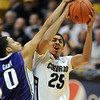 "Spencer Dinwidie of Colorado is fouled by Abdul Gaddy of Washington during the second half of the January 5, 2012 game in Boulder.<br /> For more photos of the game, go to  <a href=""http://www.dailycamera.com"">http://www.dailycamera.com</a>.<br /> January 5, 2012 / Cliff Grassmick"