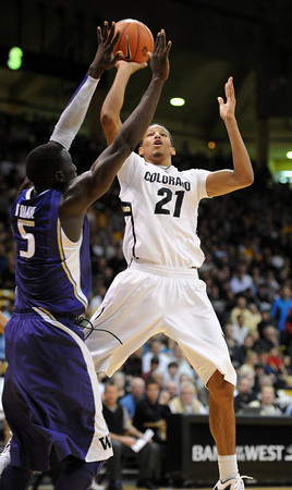 "Andre Roberson of Colorado shoots over Aziz N'Diaye of Washington<br /> during the first half of the January 5, 2012 game in Boulder.<br /> For more photos of the game, go to  <a href=""http://www.dailycamera.com"">http://www.dailycamera.com</a>.<br /> January 5, 2012 / Cliff Grassmick"
