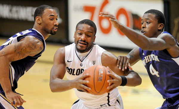 """Desmond Simmons, left, and Hikeem Stewart, both of Washington, try to stop Shannon Sharpe of CU<br /> during the second half of the January 5, 2012 game in Boulder.<br /> For more photos of the game, go to  <a href=""""http://www.dailycamera.com"""">http://www.dailycamera.com</a>.<br /> January 5, 2012 / Cliff Grassmick"""