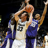 "Austin Dufault (33) of Colorado, is trapped by Darnell Gant, left, and Desmond Simmons, both of Washington,<br /> during the first half of the January 5, 2012 game in Boulder.<br /> For more photos of the game, go to  <a href=""http://www.dailycamera.com"">http://www.dailycamera.com</a>.<br /> January 5, 2012 / Cliff Grassmick"