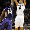 "Askia Booker of CU shoots ver Tony Wroten of Washington<br /> during the first half of the January 5, 2012 game in Boulder.<br /> For more photos of the game, go to  <a href=""http://www.dailycamera.com"">http://www.dailycamera.com</a>.<br /> January 5, 2012 / Cliff Grassmick"