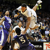 "Carlon Brown of CU flies over Aziz N'Diaye of Washington<br /> during the first half of the January 5, 2012 game in Boulder.<br /> For more photos of the game, go to  <a href=""http://www.dailycamera.com"">http://www.dailycamera.com</a>.<br /> January 5, 2012 / Cliff Grassmick"