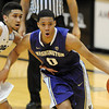"Abdul Gaddy, right, of Washington, dribbles around Askia Booker of Colorado during the first half of the January 5, 2012 game in Boulder.<br /> For more photos of the game, go to  <a href=""http://www.dailycamera.com"">http://www.dailycamera.com</a>.<br /> January 5, 2012 / Cliff Grassmick"