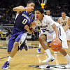 "Spencer Dinwiddie of CU drives into Abdul Gaddy of Washington<br /> during the first half of the January 5, 2012 game in Boulder.<br /> For more photos of the game, go to  <a href=""http://www.dailycamera.com"">http://www.dailycamera.com</a>.<br /> January 5, 2012 / Cliff Grassmick"