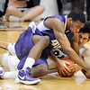 "Shawn Kemp Jr, left, of Washington, and Sabatino Chen of Colorado, battle for a loose ball during the second half of the January 5, 2012 game in Boulder.<br /> For more photos of the game, go to  <a href=""http://www.dailycamera.com"">http://www.dailycamera.com</a>.<br /> January 5, 2012 / Cliff Grassmick"