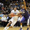 "Andre Roberson of Colorado drives past Desmond Simmons of Washington during the first half of the January 5, 2012 game in Boulder.<br /> For more photos of the game, go to  <a href=""http://www.dailycamera.com"">http://www.dailycamera.com</a>.<br /> January 5, 2012 / Cliff Grassmick"