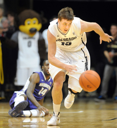 """Shane Harris-Tunks of CU gets a steal against Washington<br /> during the first half of the January 5, 2012 game in Boulder.<br /> For more photos of the game, go to  <a href=""""http://www.dailycamera.com"""">http://www.dailycamera.com</a>.<br /> January 5, 2012 / Cliff Grassmick"""