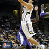 "Sabatino Chen of CU drives to the basket against Washington<br /> during the first half of the January 5, 2012 game in Boulder.<br /> For more photos of the game, go to  <a href=""http://www.dailycamera.com"">http://www.dailycamera.com</a>.<br /> January 5, 2012 / Cliff Grassmick"