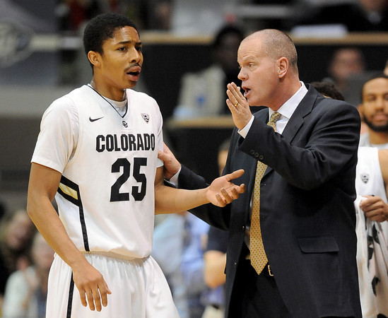 "Spencer Dinwiddie of CU gets some instruction from coach Tad Boyle<br /> during the first half of the January 5, 2012 game in Boulder.<br /> For more photos of the game, go to  <a href=""http://www.dailycamera.com"">http://www.dailycamera.com</a>.<br /> January 5, 2012 / Cliff Grassmick"