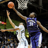 "Spencer Dinwiddie  of Colorado has his shot blocked by Terrence Ross of Washington during the first half of the January 5, 2012 game in Boulder.<br /> For more photos of the game, go to  <a href=""http://www.dailycamera.com"">http://www.dailycamera.com</a>.<br /> January 5, 2012 / Cliff Grassmick"