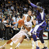 "Spencer Dinwiddie of CU, slips down while driving on Aziz N'Diaye of Washington during the first half of the January 5, 2012 game in Boulder.<br /> For more photos of the game, go to  <a href=""http://www.dailycamera.com"">http://www.dailycamera.com</a>.<br /> January 5, 2012 / Cliff Grassmick"
