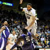 """Carlon Brown (30) of Colorado, throws up a shot  and is fouled by Aziz N'Diaye of Washington during the first half of the January 5, 2012 game in Boulder.<br /> For more photos of the game, go to  <a href=""""http://www.dailycamera.com"""">http://www.dailycamera.com</a>.<br /> January 5, 2012 / Cliff Grassmick"""