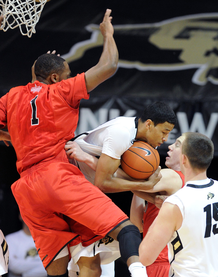 "Andre Roberson of CU, takes in a rebound in front of Wes Cole of Hartford, during the first half of the December 29, 2012 game in Boulder.<br /> For more photos of the game, go to  <a href=""http://www.dailycamera.com"">http://www.dailycamera.com</a>.<br /> Cliff Grassmick / December 29, 2012"