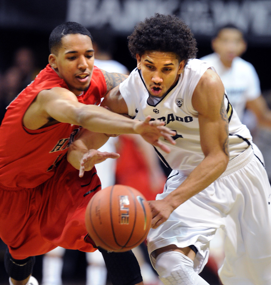 "Yolonzo Moore, left, of Hartford, and Askia Booker of CU, chase down a loose ball during the first half of the December 29, 2012 game in Boulder.<br /> For more photos of the game, go to  <a href=""http://www.dailycamera.com"">http://www.dailycamera.com</a>.<br /> Cliff Grassmick / December 29, 2012"