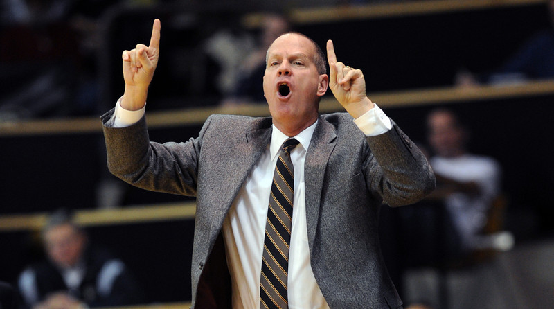 """CU coach Tad Boyle works the Hartford game during the first half of the December 29, 2012 game in Boulder.<br /> For more photos of the game, go to  <a href=""""http://www.dailycamera.com"""">http://www.dailycamera.com</a>.<br /> Cliff Grassmick / December 29, 2012"""