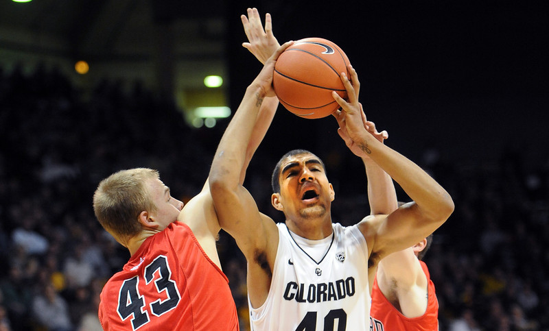 "Josh Scott of CU goes to the basket on Nate Sikma of Hartford, during the first half of the December 29, 2012 game in Boulder.<br /> For more photos of the game, go to  <a href=""http://www.dailycamera.com"">http://www.dailycamera.com</a>.<br /> Cliff Grassmick / December 29, 2012"