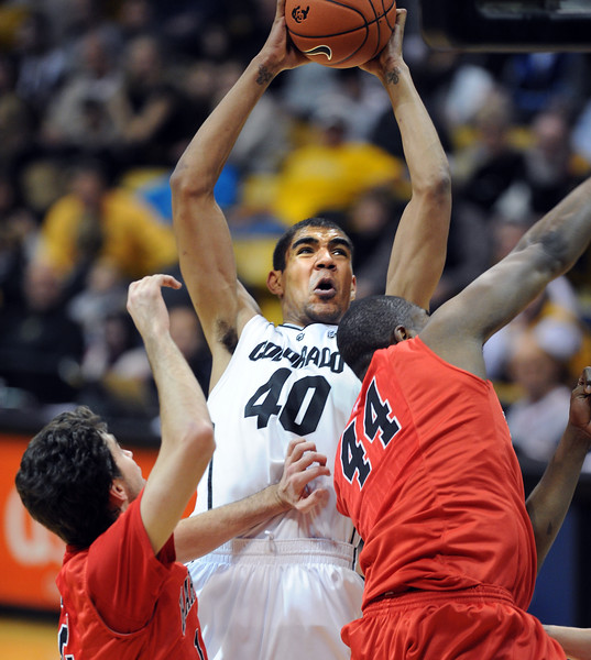 "Josh Scott of CU goes back up on Oren Faulk of Hartford, after an offensive rebound, during the second half of the December 29, 2012 game in Boulder.<br /> For more photos of the game, go to  <a href=""http://www.dailycamera.com"">http://www.dailycamera.com</a>.<br /> Cliff Grassmick / December 29, 2012"