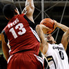 "University of Colorado's Askia Booker takes a shot under the arms of Stanford University's Josh Owens during a basketball game on Thursday, Feb. 23, at the Coors Event Center on the CU campus in Boulder. For more photos of the game go to  <a href=""http://www.dailycamera.com"">http://www.dailycamera.com</a><br /> Jeremy Papasso/ Camera"