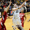"University of Colorado's Austin Dufault takes a shot over Stanford University's Dwight Powell, left, during a basketball game on Thursday, Feb. 23, at the Coors Event Center on the CU campus in Boulder. For more photos of the game go to  <a href=""http://www.dailycamera.com"">http://www.dailycamera.com</a><br /> Jeremy Papasso/ Camera"