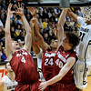 "Stanford University's Stefan Nastic, No. 4, Josh Huestis, No. 24, and John Gage fight for a rebound during a basketball game against the University of Colorado on Thursday, Feb. 23, at the Coors Event Center on the CU campus in Boulder. For more photos of the game go to  <a href=""http://www.dailycamera.com"">http://www.dailycamera.com</a><br /> Jeremy Papasso/ Camera"