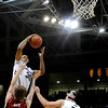 "University of Colorado's Carlon Brown drives to the hoop over  Stanford University's John Gage during a basketball game on Thursday, Feb. 23, at the Coors Event Center on the CU campus in Boulder. For more photos of the game go to  <a href=""http://www.dailycamera.com"">http://www.dailycamera.com</a><br /> Jeremy Papasso/ Camera"