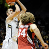 "University of Colorado's Austin Dufault takes a shot over Stanford University's Andrew Zimmermann during a basketball game on Thursday, Feb. 23, at the Coors Event Center on the CU campus in Boulder. For more photos of the game go to  <a href=""http://www.dailycamera.com"">http://www.dailycamera.com</a><br /> Jeremy Papasso/ Camera"