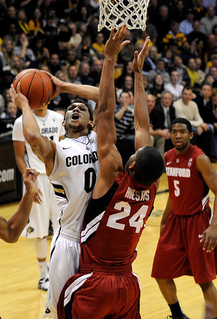 "University of Colorado's Askia Booker takes a shot over Stanford University's Josh Huestis during a basketball game on Thursday, Feb. 23, at the Coors Event Center on the CU campus in Boulder. For more photos of the game go to  <a href=""http://www.dailycamera.com"">http://www.dailycamera.com</a><br /> Jeremy Papasso/ Camera"