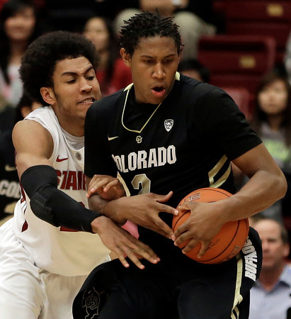 Colorado's Xavier Johnson, right, keeps the ball from Stanford's Josh Huestis during the second half of an NCAA college basketball game Wednesday, Feb. 27, 2013, in Stanford, Calif. (AP Photo/Ben Margot)