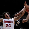 Stanford's Josh Huestis (24) fights for a rebound with Colorado's Xavier Johnson, right, during the first half of an NCAA college basketball game Wednesday, Feb. 27, 2013, in Stanford, Calif. (AP Photo/Ben Margot)