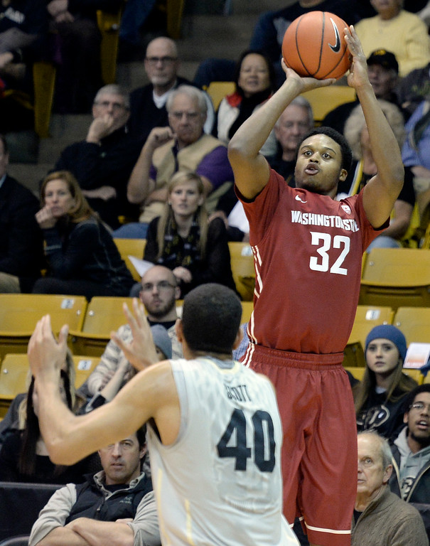 . Washington State\'s Que Johnson takes a shot in front of Josh Scott during an NCAA game against Colorado on Wednesday, Feb. 5, at the Coors Event Center in Boulder.  Jeremy Papasso/ Camera