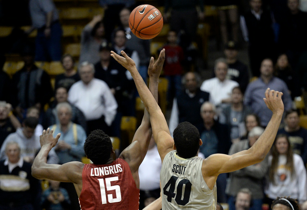 . Colorado\'s Josh Scott tips off with Junior Longrus during an NCAA game against Washington State on Wednesday, Feb. 5, at the Coors Event Center in Boulder.  Jeremy Papasso/ Camera